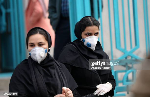 People wear masks after deaths and new confirmed cases revealed from the coronavirus in Tehran, Iran on February 21, 2020.