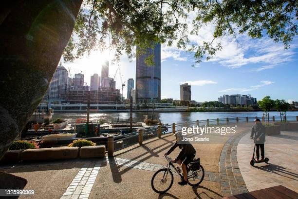People wear masks at Southbank, on June 29, 2021 in Brisbane, Australia. New restrictions have come into effect across parts of Queensland as of 1 am...