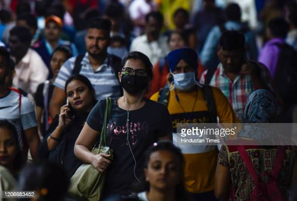People wear masks for protection from Corona virus at Andheri Station on March 11 2020 in Mumbai India