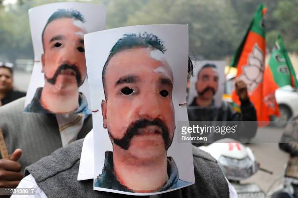 People wear masks in the likeness of Indian Air Force pilot Abhinandan Varthaman during a rally in New Delhi India on Saturday March 2 2019 An Indian...
