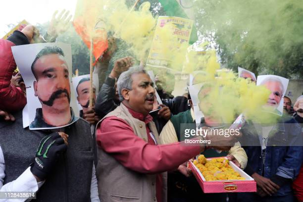 People wear masks in the likeness of Indian Prime Minister Narendra Modi right and Indian Air Force pilot Abhinandan Varthaman during a rally in New...