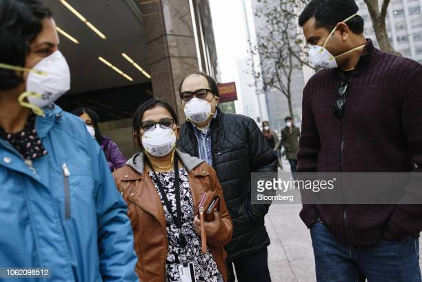 People wear masks while smoke from the Camp Fire fills the air in San Francisco California US on Thursday Nov 15 2018 The smoke from Californias...