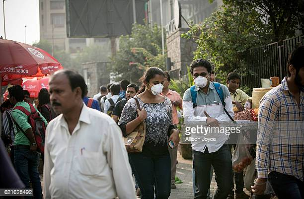 People wear pollution masks amid heavy dust and smog November 7 2016 in Delhi India People in India's capital city are struggling with heavily...