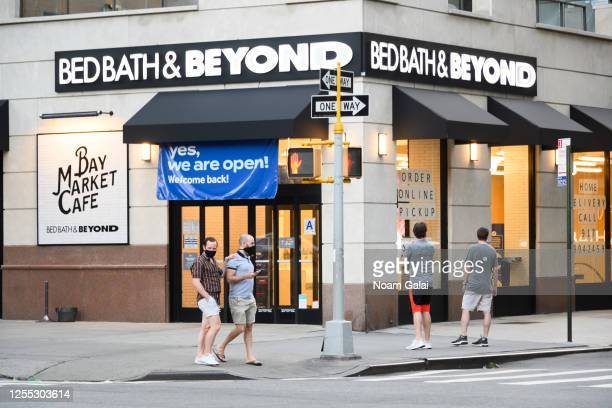People wear protective face mask outside Bed Bath & Beyond in Kips Bay as New York City moves into Phase 3 of re-opening following restrictions...