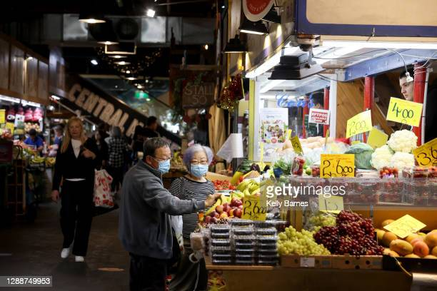 People wear protective face masks as they shop at the Adelaide Central Market on December 01, 2020 in Adelaide, Australia. COVID-19 restrictions have...