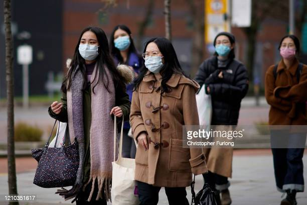 People wear protective face masks for protection against the COVID19 coronavirus on March 04 2020 in Manchester United Kingdom During a London press...