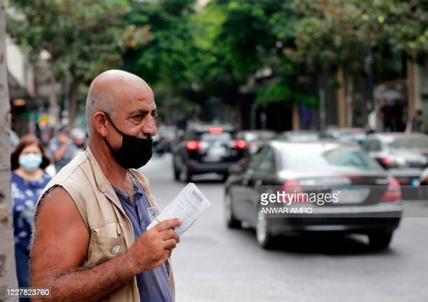 People wear protective face masks in Beirut on July 29, 2020 ahead of lockdown measures after a spike in new cases threatened to overwhelm the...