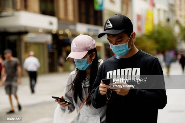People wear surgical masks in Adelaide on April 01, 2020 in Adelaide, Australia. The Australian government has introduced further restrictions on...