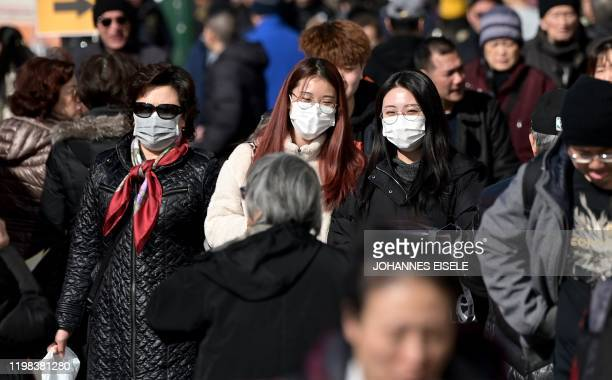 People wear surgical masks in fear of the coronavirus in Flushing a neighborhood in the New York City borough of Queens on February 3 2020 China's...