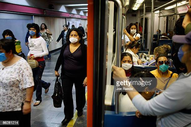 People wear surgical masks to help prevent being infected with the swine flu as they ride the subway on April 29 2009 in Mexico City Mexico Reports...