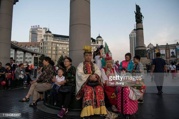 People wear traditonal clothes at central street to celebrate upcoming Duanwu Festival in Harbin city of China on June 62019The Dragon Boat Festival...