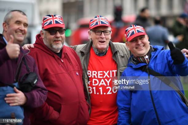 People wear Union Jack hats and Brexit Day t shirts in Parliament Square as people prepare for Brexit on January 31, 2020 in London, United Kingdom....