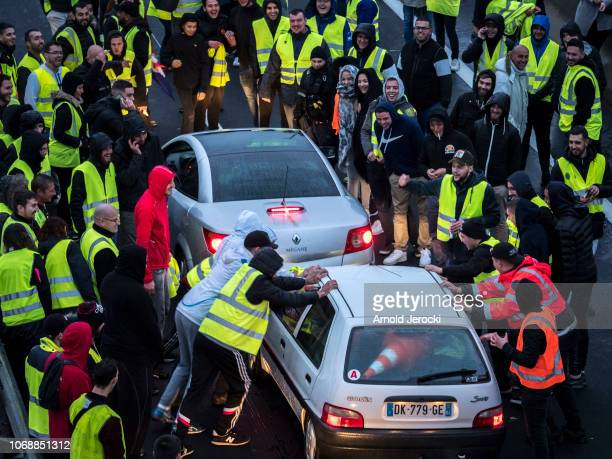 People wear yellow jackets in protest against the rising prices of fuel and oil on November 17 2018 in Avignon France Without no official...