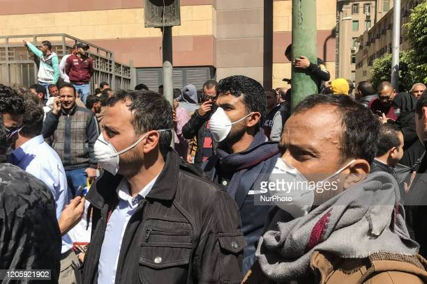 People wearing a protective mask in Cairo Egypt on March 8 2020 Egyptians who wants to travel gathering front of egyptian health ministry to do...