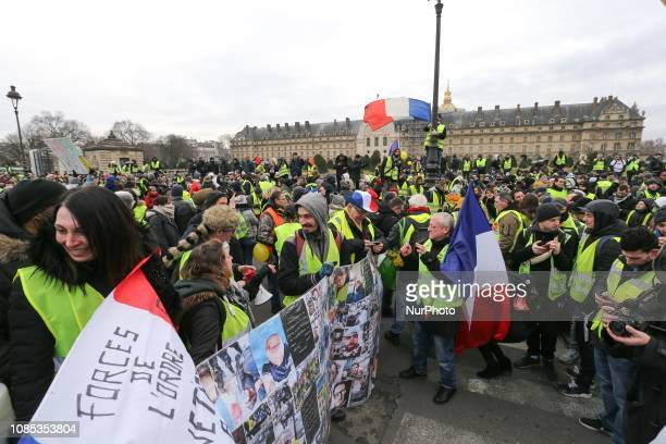 People wearing a yellow vest gather in front the Hotel national voice over Invalides in Paris on January 19 2019 during a demonstration called by the...