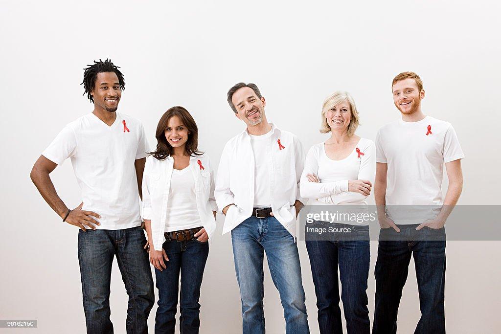 People wearing aids awareness ribbons : Stock Photo