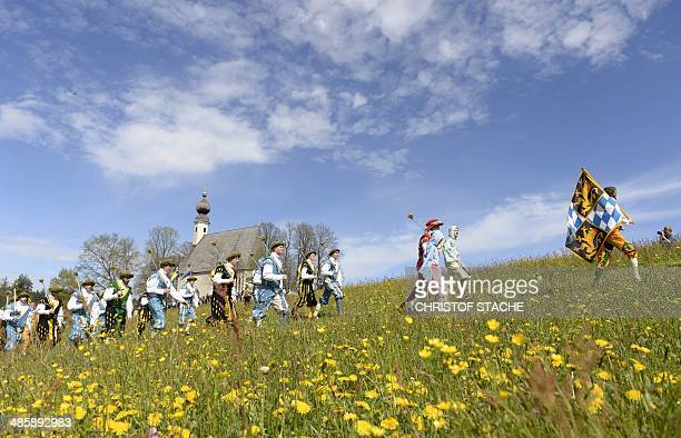 People wearing ancient and traditional Bavarian dresses take part in the traditional St Georgi Ride on Easter Monday April 21 2014 in Traunstein...