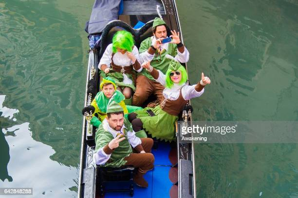 People wearing carnival costume pose for a picture on February 19 2017 in Venice Italy The 2017 Venice Carnival will run from 11 to 28 February and...