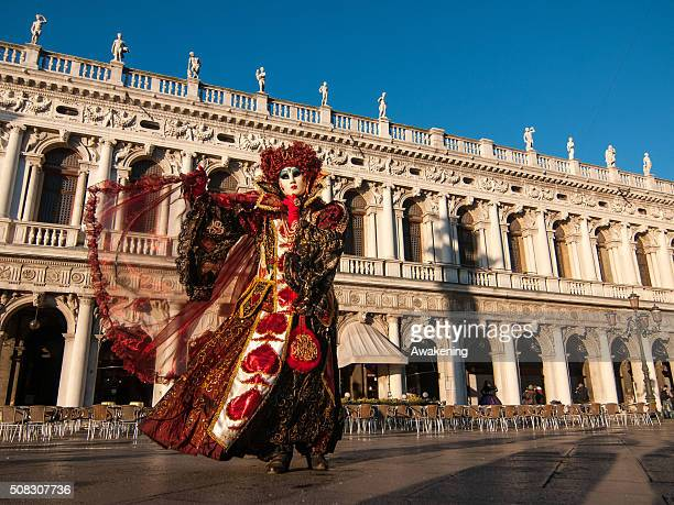 People wearing carnival costume pose in St Mark square during the 2016 Venice Carnival on February 4 2016 in Venice Italy The 2016 Carnival of Venice...