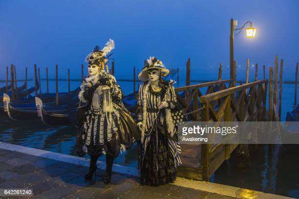 People wearing carnival costume pose in St Mark square during the 2017 Venice Carnival on February 17 2017 in Venice Italy The 2017 Carnival of...