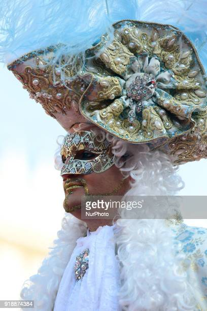 People wearing carnival costumes attend the event of the Eagle Flight on February 11 2018 in Venice Italy The theme for the 2018 edition of Venice...