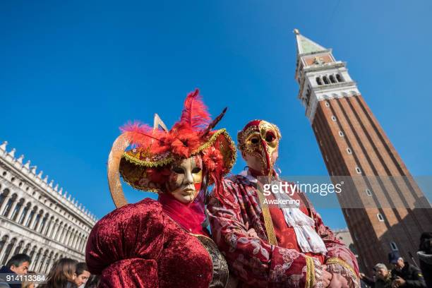 People wearing carnival costumes attend the Flight of Angel in Saint Mark's Square on February 4 2018 in Venice Italy The theme for the 2018 edition...