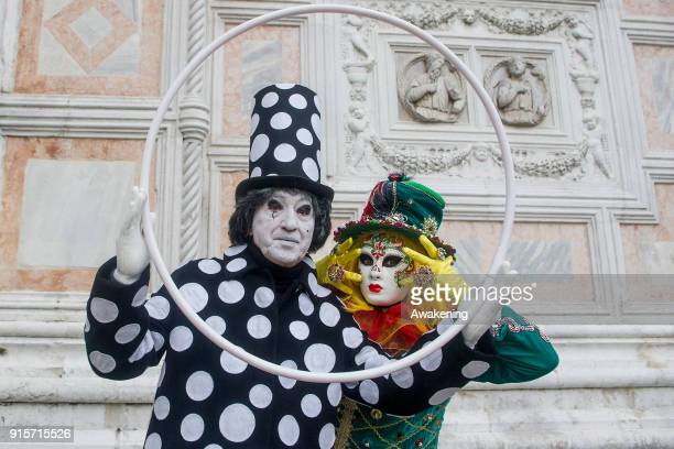 People wearing carnival costumes pose in St Mark square on February 8 2018 in Venice Italy The theme for the 2018 edition of Venice Carnival is...