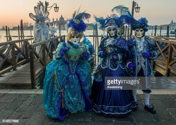 People wearing carnival costumes pose in St Mark square on February 10 2018 in Venice Italy The theme for the 2018 edition of Venice Carnival is...