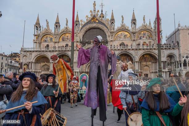 People wearing costumes attend the traditional events of Carnival 'Cutting off the Bull's head' and 'Dance of the Masks' on February 8 2018 in Venice...