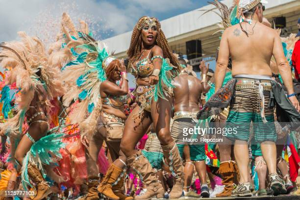 people wearing costumes dancing at the sambadrome during the carnival celebration at port of spain, trinidad and tobago. - steel drum stock photos and pictures
