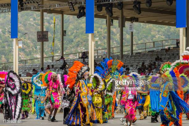 people wearing costumes dancing at the sambadrome during the carnival celebration at port of spain, trinidad and tobago. - trinidad carnival stock pictures, royalty-free photos & images