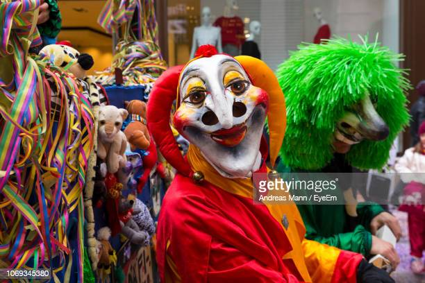 people wearing costumes during carnival - karneval stock-fotos und bilder
