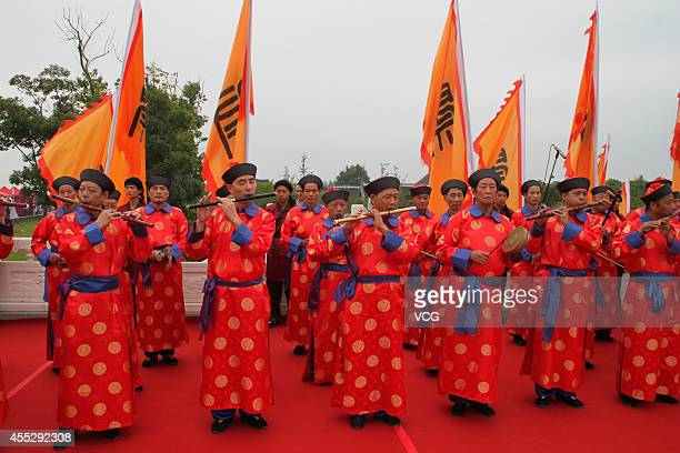 People wearing costumes of Qing dynasty officials and servants hold a seagod worship ceremony on September 11 2014 in Haining Zhejiang province of...