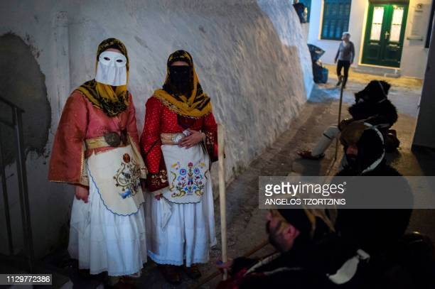 People wearing costumes take part in the Skyrian Carnival on the island of Skyros northeast of Athens on March 9 2019 In the celebrations of the...