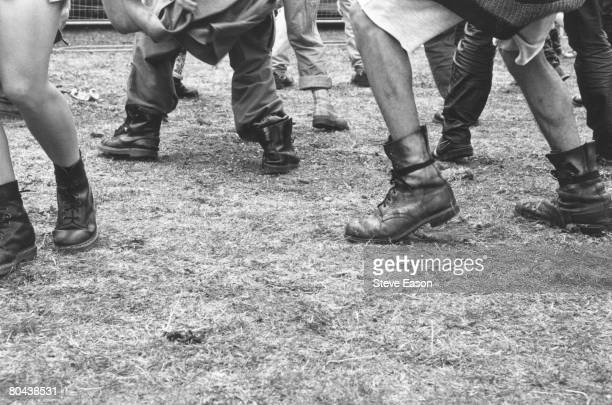 People wearing Dr Marten boots dancing at the Deptford Free Festival in south London July 1993