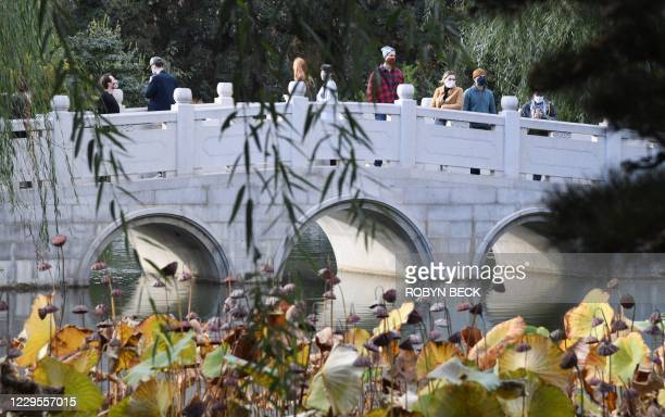 People wearing face covering to prevent the spread of COVID19 visit the Chinese Garden at The Huntington Library Art Museum and Botanical Gardens in...