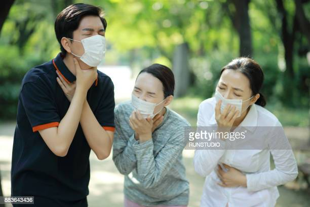 People wearing face mask and coughing