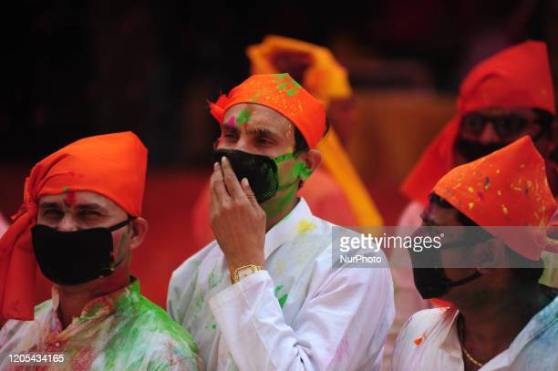 people wearing face mask to prevent from COVID19 take part in an event to celebrate the Hindu festival of Holi for the children with cerebral palsy...