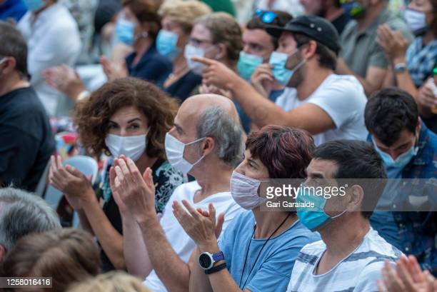 People wearing face masks attend the Perico Sambeat Plays Zappa project performs on stage during 55th edition of the Heineken Jazzaldia Festival on...