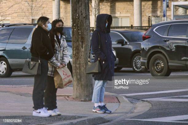 People wearing face masks during the novel coronavirus pandemic in Toronto, Ontario, Canada on April 01, 2021. The Ontario government is implementing...