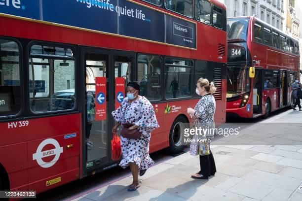 People wearing face masks on public transport by TfL buses on the day that it was announced that the Coronavirus lockdown measures are set to ease...