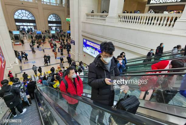 People wearing face masks ride escalators inside Hankou Railway Station on January 22 2020 in Wuhan China A new infectious coronavirus known as...