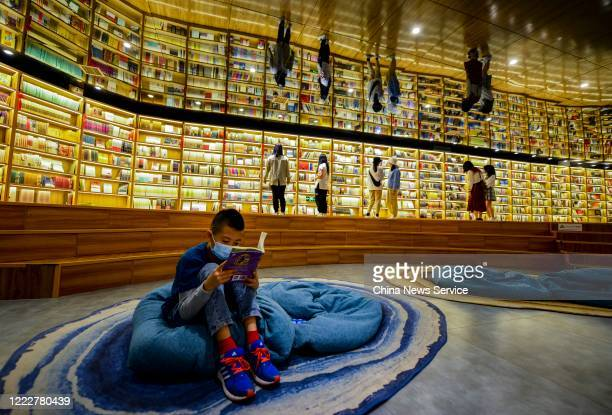 People wearing face masks visit a bookstore on the 4th day of 5day International Workers' Day holiday on May 4 2020 in Urumqi Xinjiang Uygur...