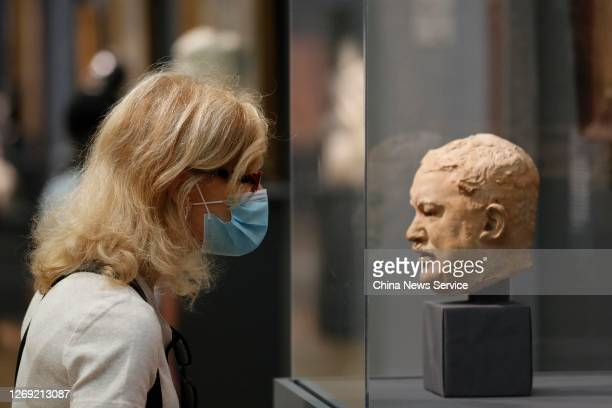 People wearing face masks visit The Metropolitan Museum of Art as it reopens to members after the pandemic closure, on August 27, 2020 in New York...