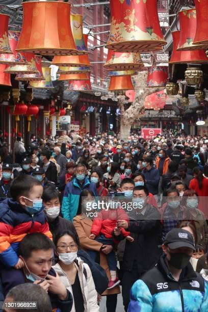 People wearing face masks visit Yuyuan Garden on the second day of the Chinese New Year, the Year of the Ox, on February 13, 2021 in Shanghai, China.