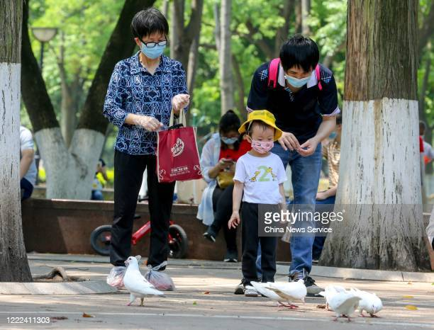 People wearing face masks visit Zhongshan Park on the second day of 5-day International Workers' Day holiday on May 2, 2020 in Wuhan, Hubei Province...