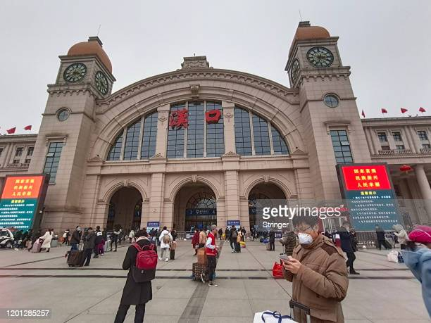 People wearing face masks walk outside Hankou Railway Station on January 22 2020 in Wuhan China A new infectious coronavirus known as 2019nCoV was...