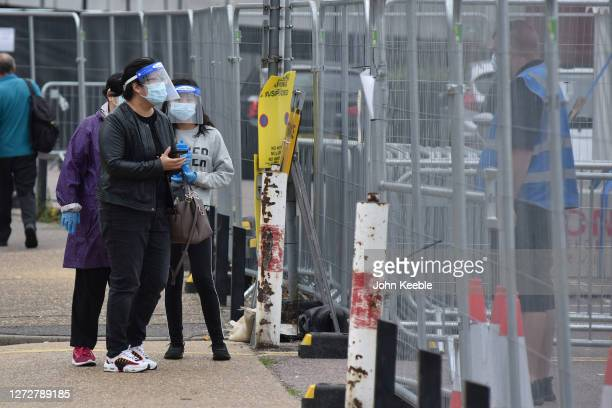 People wearing face shields masks and gloves arrive at a walk in Covid19 testing facility on September 16 2020 in Southend on Sea England The...