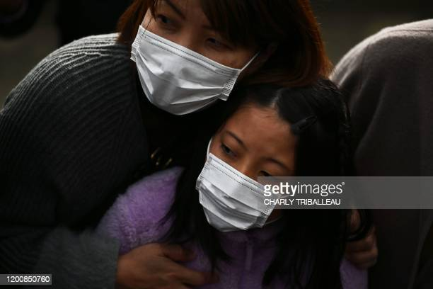 People wearing facemasks look on during a rehearsal of the Tokyo 2020 Olympics torch relay in Tokyo on February 15 2020 Olympic chiefs admitted...