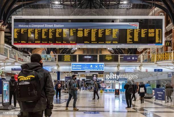 People wearing facemasks walk at Liverpool Street station in London. London has recorded a further 10,020 coronavirus cases in the past 24 hours, as...